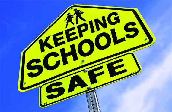 Street sign with the words 'Keeping Schools Safe'